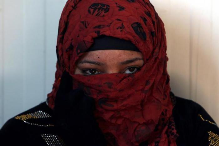 A Sunni Muslim woman who fled the Islamic State's strongholds.
