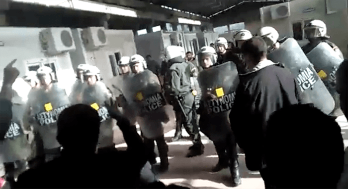 A still from video shows Greek police at the VIAL detention center on Chios as deportees protest their pending return to Turkey on April 3, 2016.