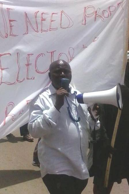 Opposition activist Solo Sandeng at an April 14, 2016 protest for electoral reform in Serrekunda, a suburb of Banjul. Gambian police officers broke up the protest and arrested Sandeng, who was subsequently beaten to death in state custody.