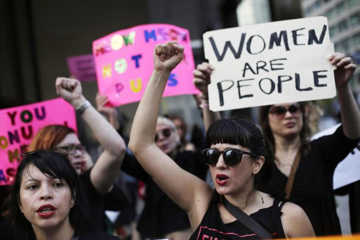 Women take part in a protest against then Republican presidential candidate Donald Trump outside the Trump International Hotel and Tower in Chicago, Illinois, U.S. October 18, 2016