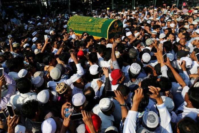 Supporters carry the coffin of U Ko Ni after he was shot and killed in Rangoon, Burma on January 30, 2017.