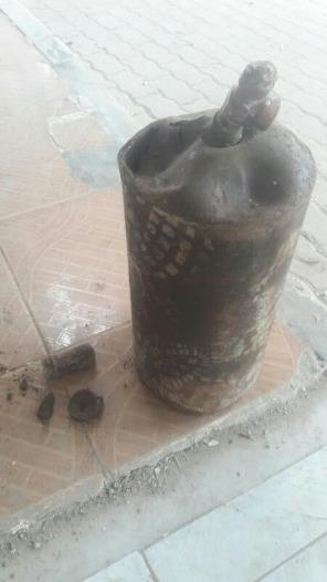 Deformed gas cylinder that a Syria Civil Defense member said was found at the site of a March 29 attack in the Qaboun neighborhood in eastern Damascus, which is controlled by armed groups fighting the government.