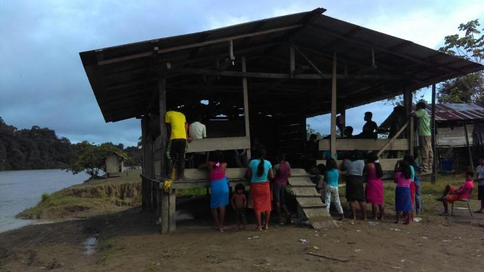 Wounaan people gather in a community building by the San Juan river, in Chocó, Colombia, March 2017.