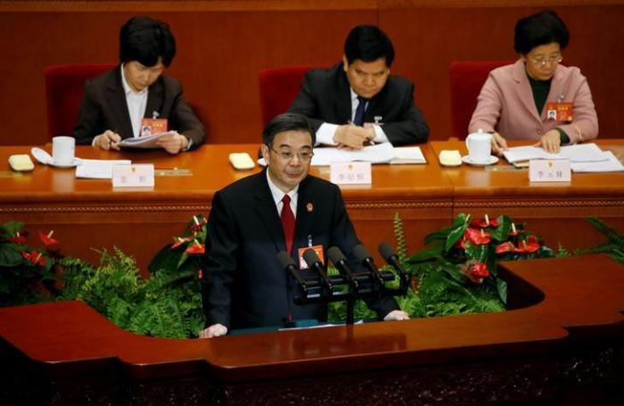 Zhou Qiang, president of China's Supreme People's Court, gives a speech during the National People's Congress in Beijing on March 12, 2017.
