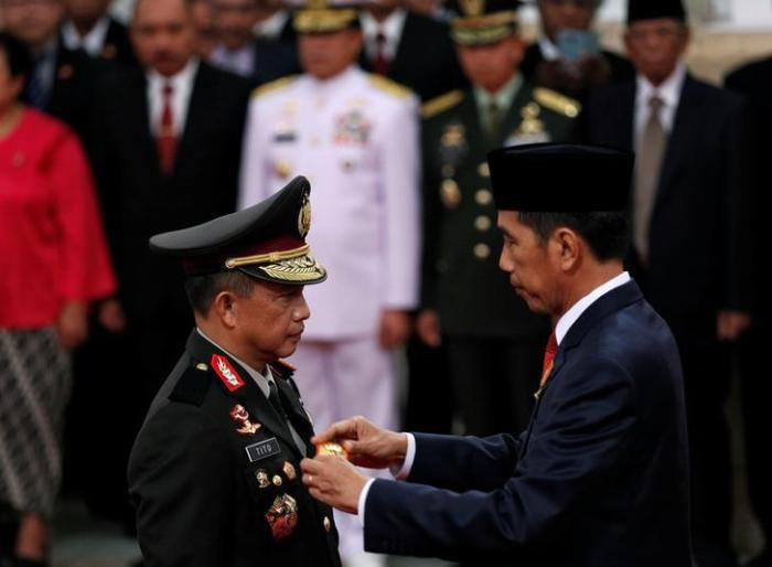 National police chief Gen. Tito Karnavian and President Joko Widodo at Karnavian's inauguration in Jakarta, Indonesia, on July 13, 2016.
