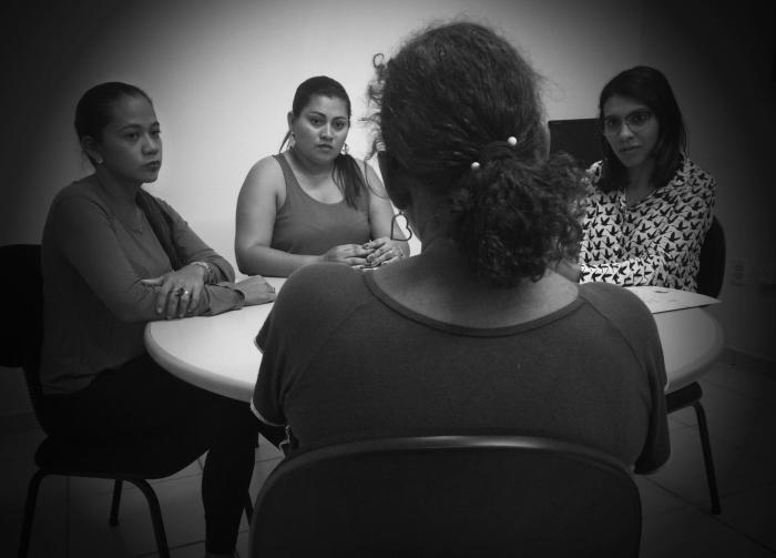 Staff from the Humanitarian Support Center for Women (CHAME, in Portuguese) listen to a woman in Boa Vista, Roraima, on February 17, 2017. CHAME provides legal, psychological, and social support to survivors of domestic violence.