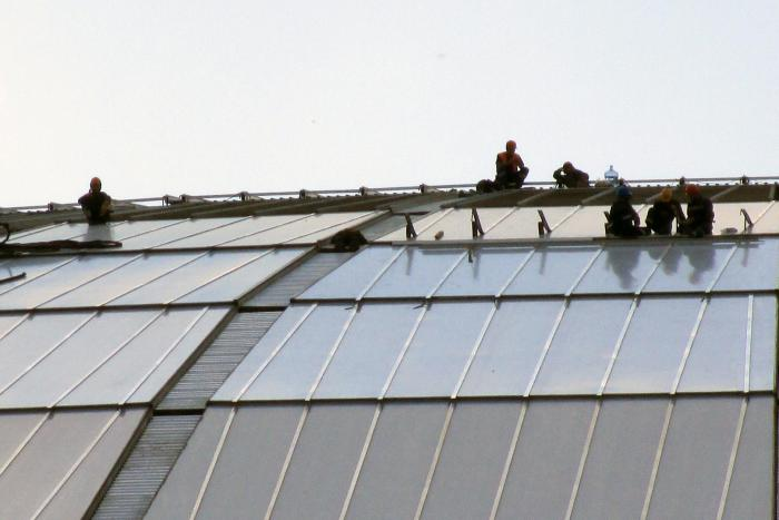 Workers on the roof of the Luzhniki Stadium, a 2018 World Cup venue, in Moscow, Russia in July 2016.