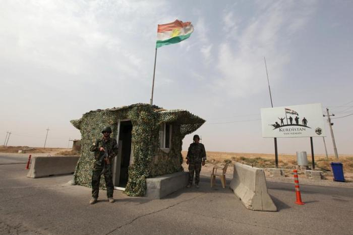 Peshmerga forces stand guard at a checkpoint in northern Iraq.