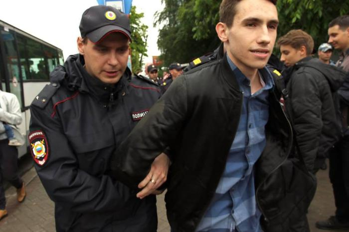 12 June: Police detain Oleg Alexeev during an anti-corruption protest in the city centre of Kaliningrad, Russia.