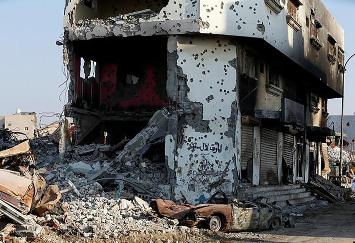 Remains of cars and buildings are seen following a security campaign against Shi'ite Muslim gunmen in the town of Awamiya, in the eastern governorate of Qatif, August 9, 2017.