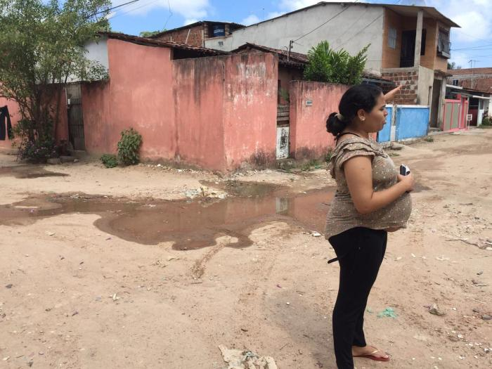 Jessica, a 24-year-old woman who was eight months pregnant when she spoke to Human Rights Watch, points to standing water in her community outside Recife, Pernambuco state.