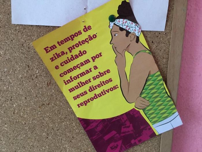 "A flyer posted at a women's community group in Passarinhos, a neighborhood in Recife, states, ""In the time of Zika, protection and care begin by informing the woman about her reproductive rights."""