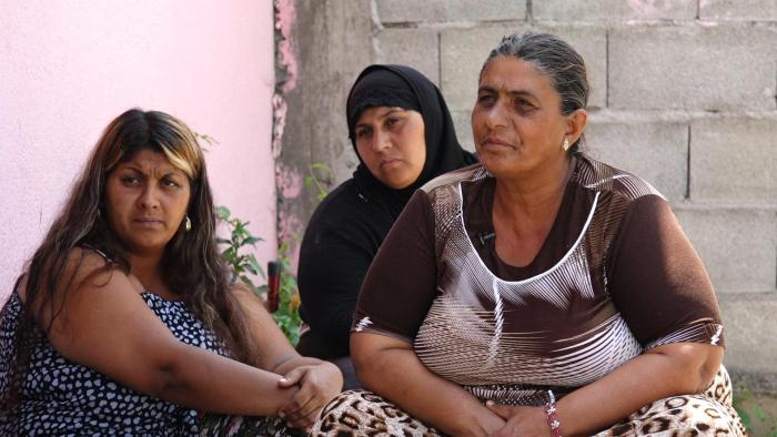 Hazbije (right), a 50-year-old mother of nine, said her husband died two years ago, leaving her to care for their children alone. Mitrovica, June 27, 2017.