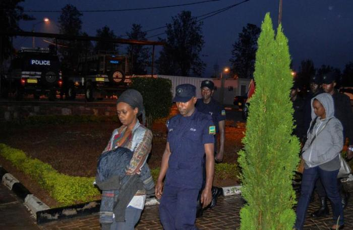 Would-be independent presidential candidate Diane Rwigara is seen being taken to the police station for interrogation in Kigali, Rwanda, September 4, 2017.