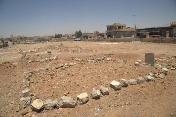 Graves of 16 civilians, including nine children, killed in a coalition airstrike on April 25 or 25, 2017, in Tabqa city.