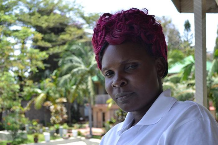 Dotto B., 31, said her employer in Oman physically assaulted her, forced her to work 20 hours a day with no rest and no day off, and paid her 50 OMR ($130) instead of 80 OMR ($208) per month as per the contract. Mwanza, Tanzania.