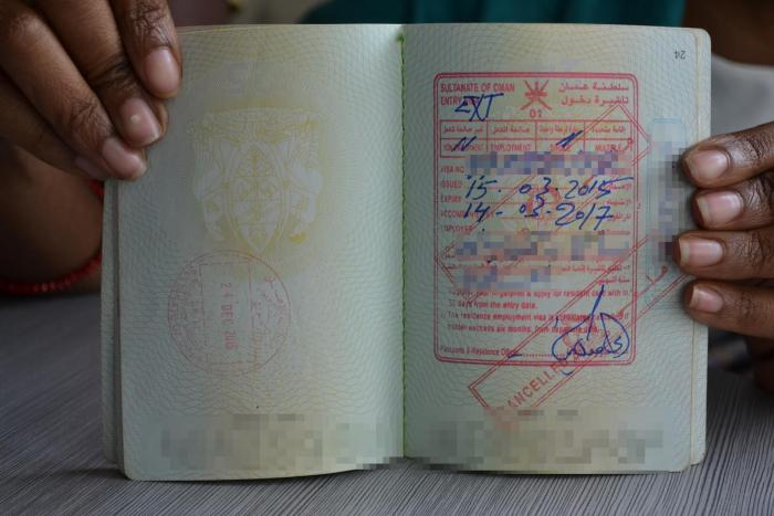 Employment visa from Oman in the passport of a former Tanzanian domestic worker. Dar es Salaam, Tanzania.
