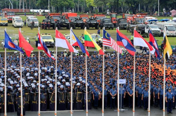Security officers gather before a ceremony for the Association of Southeast Asian Nations (ASEAN) summit in Manila, Philippines, November 5, 2017.