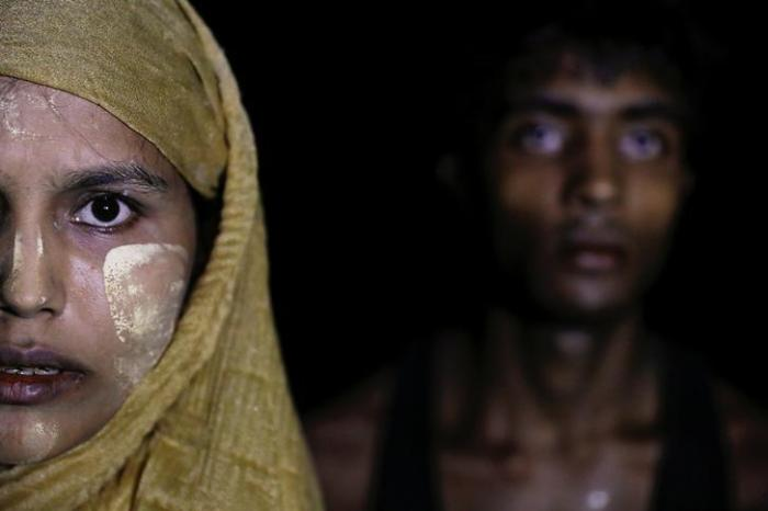 Rohingya refugees arrive at night from Myanmar to Teknaf, Bangladesh, September 27, 2017.
