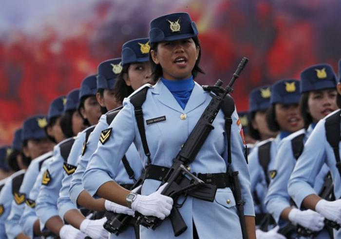 201711Asia_Indonesia_VirginityTest Members of the Indonesian Air Force parade during celebrations marking the 70th anniversary of the Air Force at Halim Perdanakusuma air base in Jakarta, Indonesia on April 9, 2016.