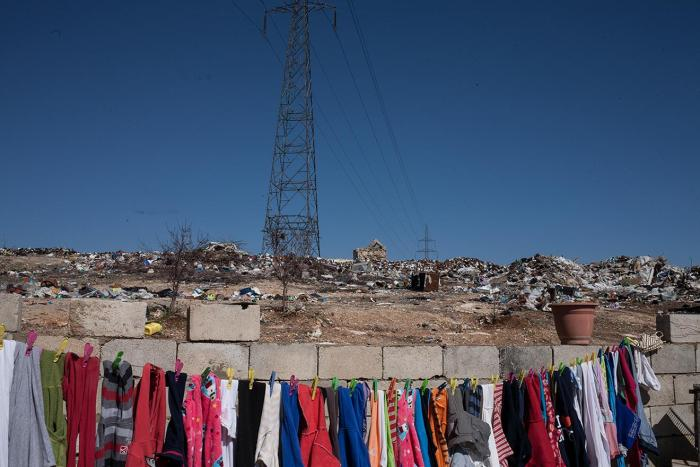 An open dump in Baalbek just meters from this family's home.