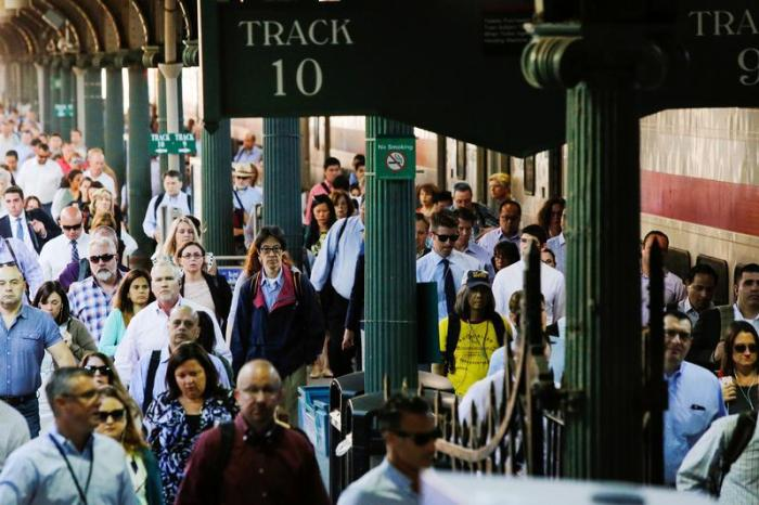 People arrive to commute to New York at the Hoboken Terminal in New Jersey, U.S. July 10, 2017.