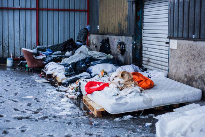 Asylum seekers and other migrants sleep outside in the snow, Calais, France, December 11, 2017.
