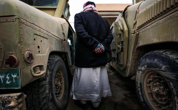 An ISIS suspect held for questioning by Iraqi forces near Mosul.