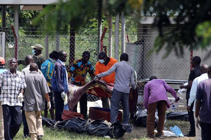 Relatives collect bodies of loved ones who were killed when Uganda security forces stormed the palace of Charles Wesley Mumbere, king of the Rwenzururu, in Kasese town, western Uganda on November 27.
