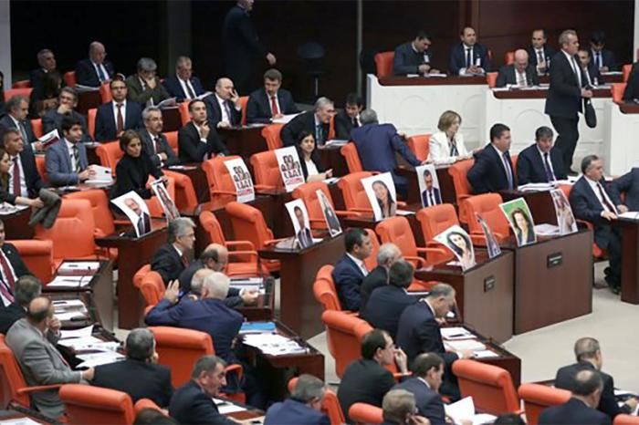 Photographs of members of parliament from the opposition Peoples' Democratic Party (HDP) displayed in the general assembly of Turkey's parliament after the MPs were detained and jailed in November 2016