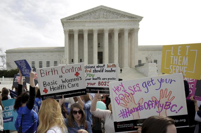 Supporters of contraception rally before Zubik v. Burwell, an appeal brought by Christian groups demanding full exemption from the requirement to provide insurance covering contraception under the Affordable Care Act, is heard by the U.S. Supreme Court.