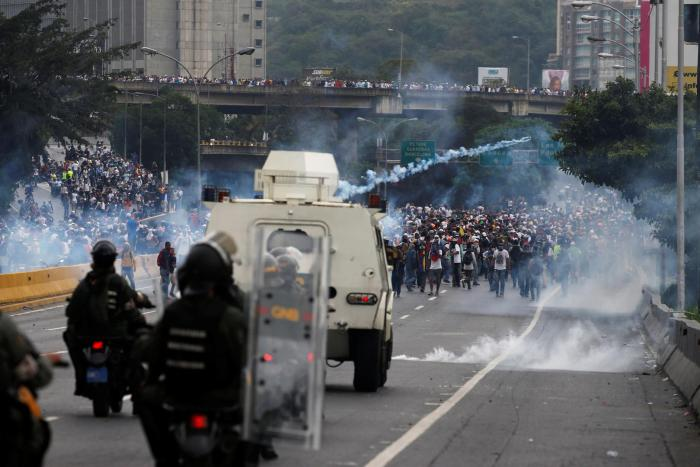 Police fire tear gas toward opposition supporters during clashes while rallying against Venezuela's President Nicolas Maduro in Caracas, Venezuela, April 20, 2017.