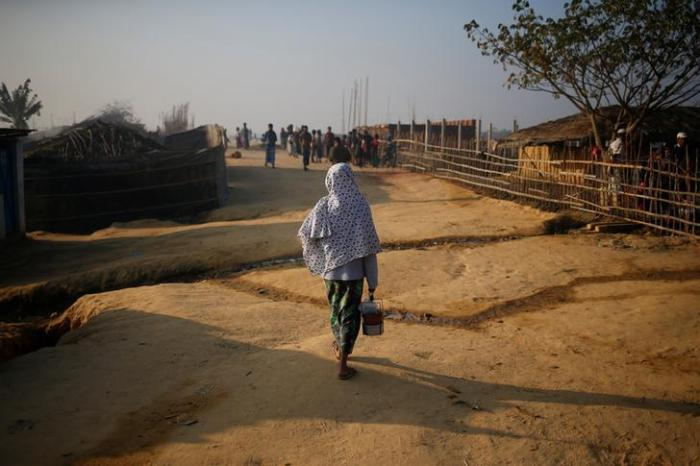 A Rohingya Muslim woman walks at the Kutupalong refugee camp in Cox's Bazar, Bangladesh, on February 4, 2017.