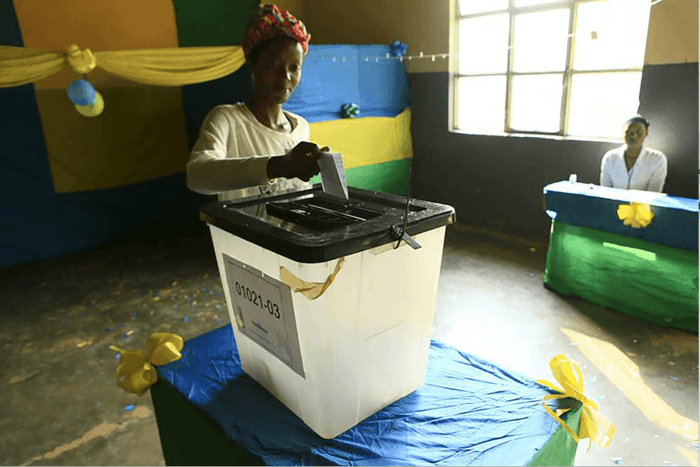A Rwandan woman casts her vote during the December 2015 referendum to amend the Constitution to allow President Paul Kagame to seek a third term.