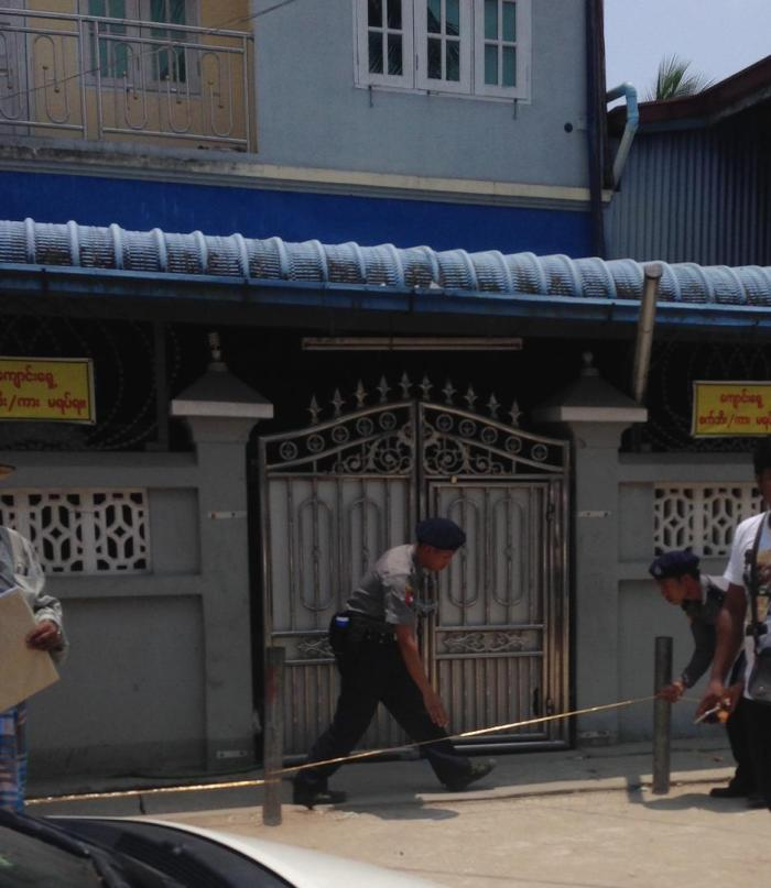 Police officers place yellow tape across the entrance to one of the madrasas in Thaketa Township, Rangoon, April 29, 2017.