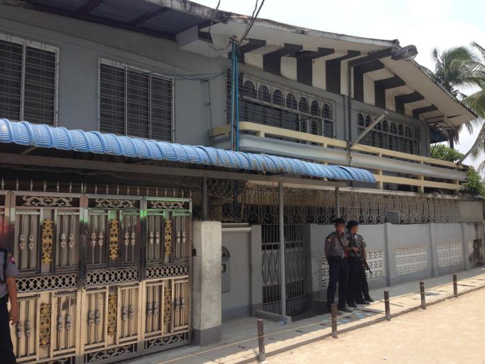 Two police officers guard one of the closed madrasas in Thaketa Township, Rangoon, after authorities inspected the building, April 29, 2017.