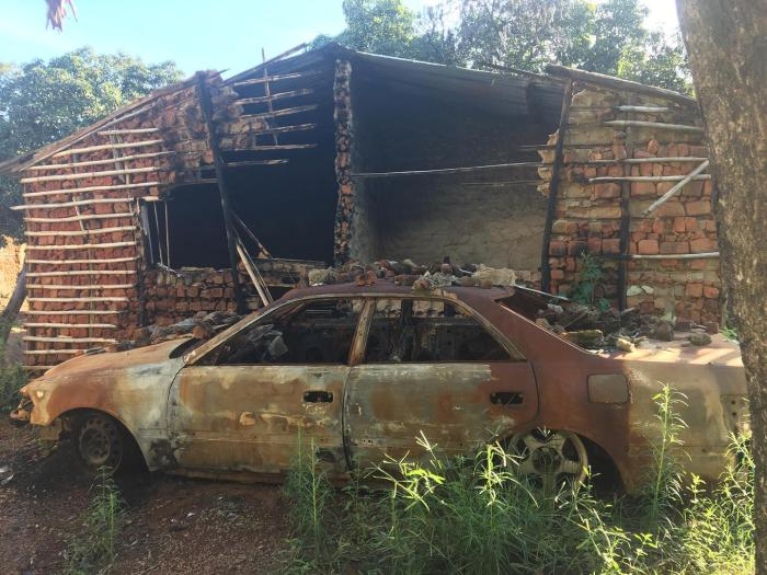 The burned house and car of Pinto, a Renamo member in Gorongosa village. Neighbors said they saw soldiers set the house and car on fire on February 17, 2016.