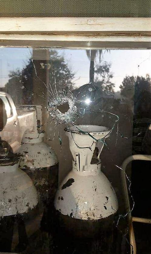 A bullet hole in the window of Morrumbala District Hospital after a raid by Renamo gunmen on August 12, 2016.