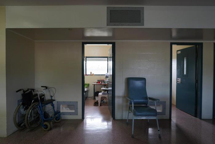 A wheelchair outside a room in Wolston Correctional Centre, Queensland.