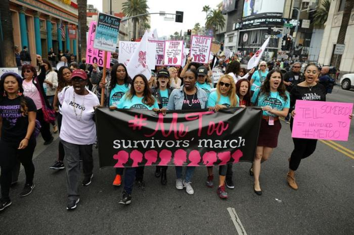 People participate in a protest march for survivors of sexual assault and their supporters in Hollywood, Los Angeles, California, U.S. November 12, 2017.