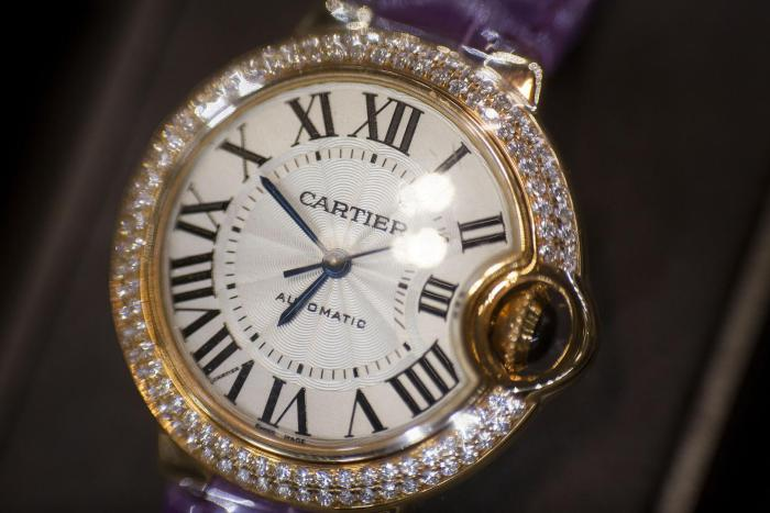 A Cartier watch sits on display at a store in New York, US, November 2014.