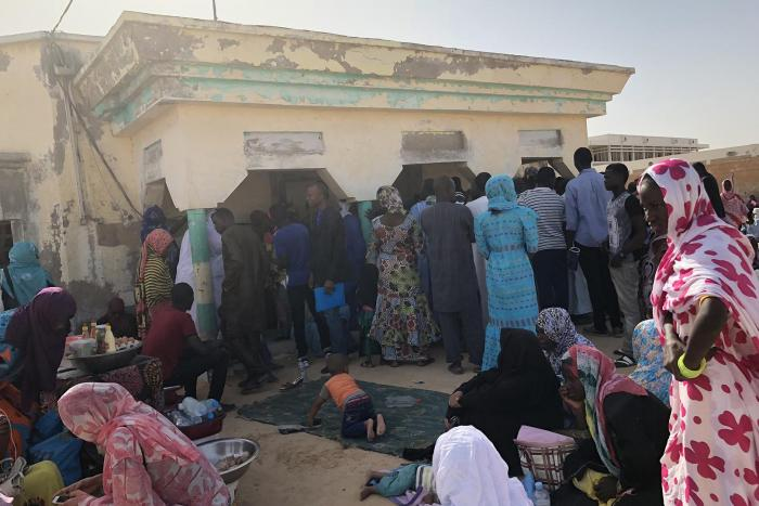 Local residents line up at local administration office hoping to complete civil registration process, Nouakchott, October 2017