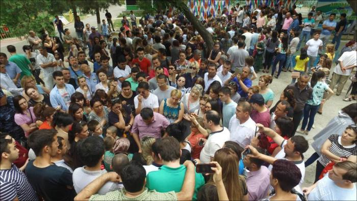 A June 2017 gathering of citizen activists in Tashkent's Bobur Park to collect signatures and demand an investigation into the murder of medical student Jasur Ibragimov.