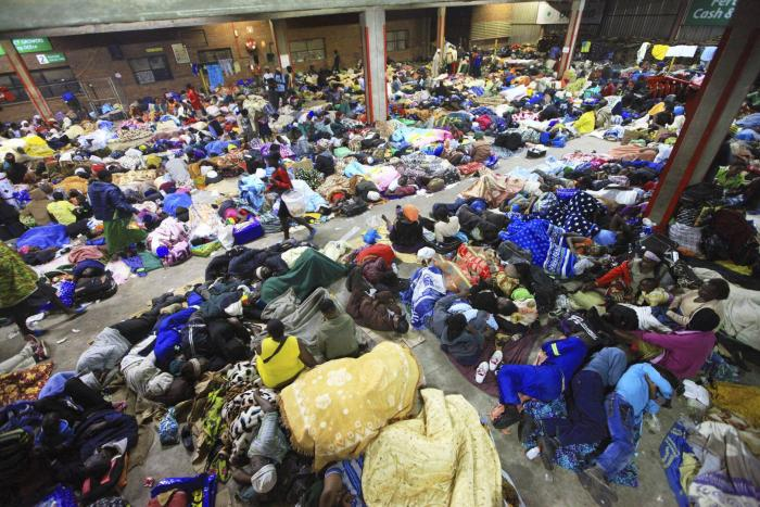 Tobacco farmers sleep in an auction house in Harare, Zimbabwe waiting to sell their tobacco crop to buyers.