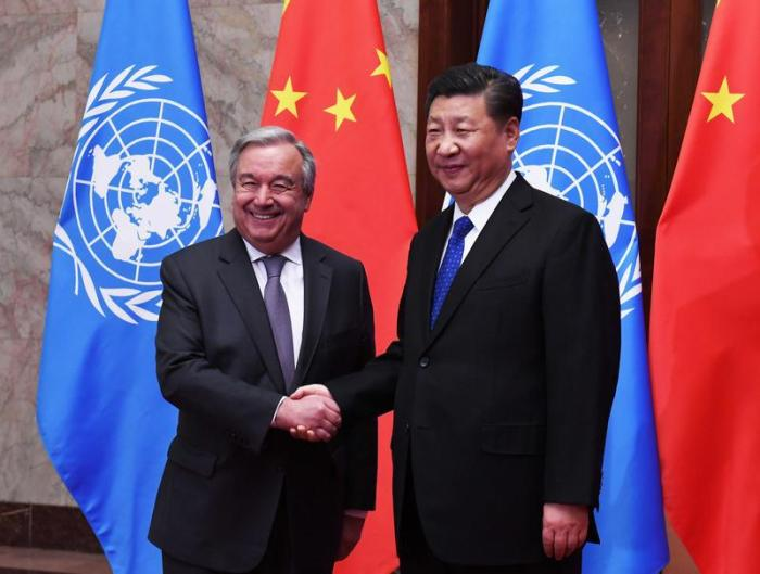 U.N. Secretary-General Antonio Guterres shakes hands with Chinese President Xi Jinping at the Great Hall of the People in Beijing, China, April 8, 2018.