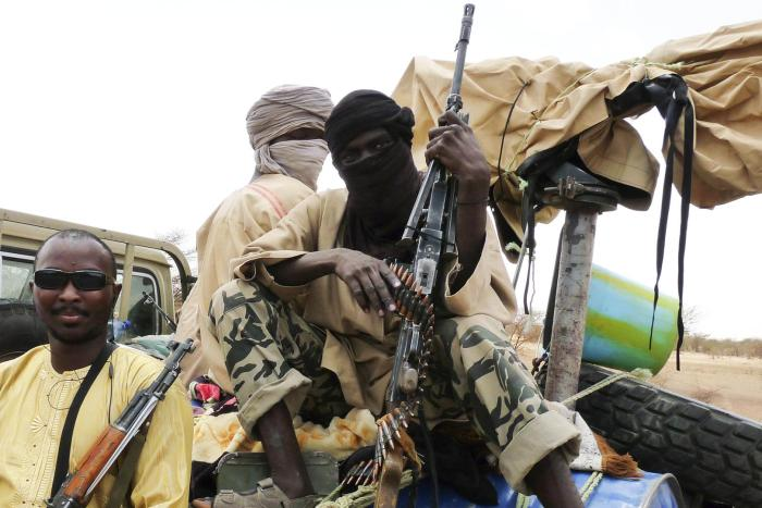 Combatants from Al-Qaeda-affiliated Islamist group Ansar Dine sit in a vehicle in Gao in northeastern Mali.