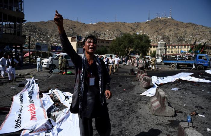 An Afghan protester cries out near the scene of the suicide attack that targeted a demonstration of mainly Shia Hazaras at Deh Mazang Square in Kabul, July 23, 2016.