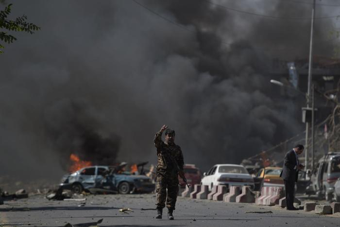 A member of the Afghan security forces stands at the site of a truck bomb attack in Kabul, May 31, 2017.