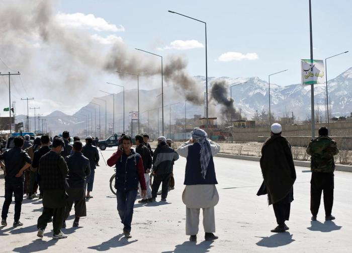 Smoke rises from the site of the car bomb attack on the police station in District Six, Kabul, March 1, 2017.