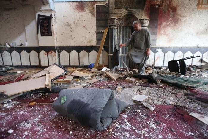 A man surveys the destruction a day after the suicide bomb attack at the Jawadiya Mosque in Herat, August 2, 2017.